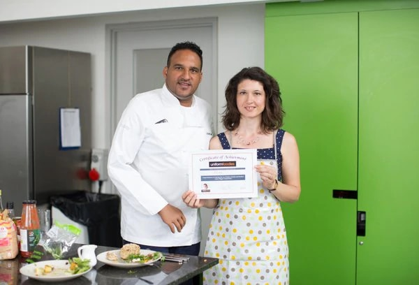 Proud winner Alida Zamparini shows off her certificate with Michael Caines